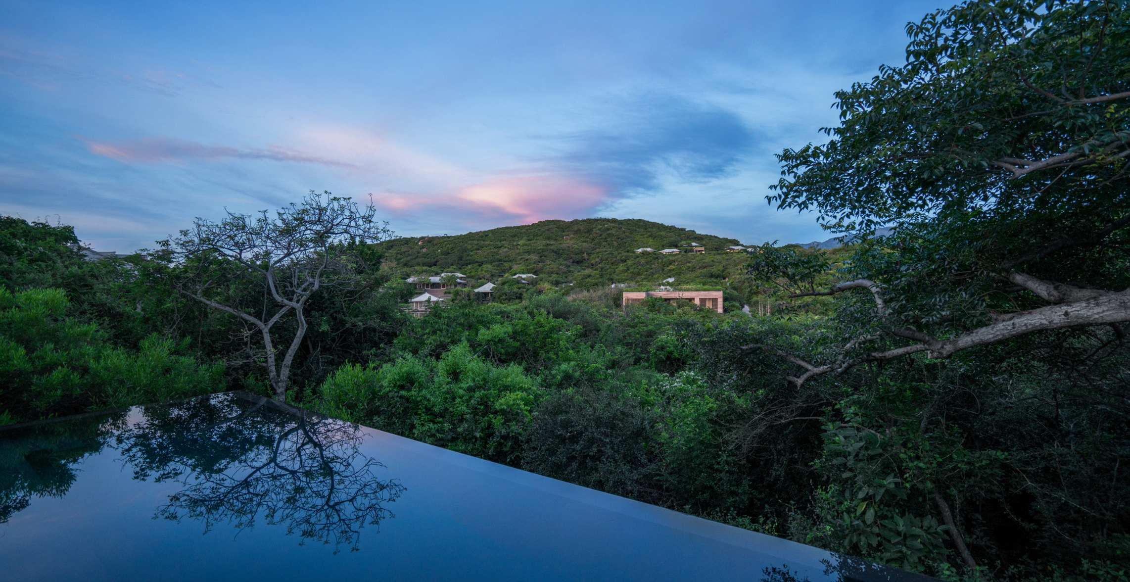 view from mountain pool villa at dusk office 14596